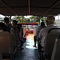 Tourists on the sight-seeing bus run by the Hippo company in Singapore Print by Ashish Agarwal
