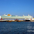 Ventura Sheildhall Calshot Spit and a Tug Poster by Terri  Waters