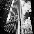 View of the empire state building and surrounding buildings and  cloudy sky from West 33rd Street ny Print by Joe Fox