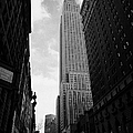 View of the empire state building from West 34th Street and Broadway junction new york city Print by Joe Fox