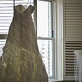 Wedding Dress and Veil by the Window Print by Mike Hope