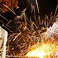 Welder cutting iron with sparks Print by Oliver Sved