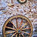 Wheel and Sun in Taromina Sicily Poster by David Smith