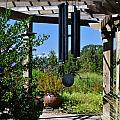 Wind Chime in a Garden Print by Mandy Judson