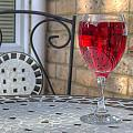 wine glass on table al fresco Poster by Fizzy Image