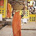 Woman Carrying Cow Dung In Basket On Print by Paul Miles