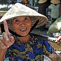Woman portrait at market in Hue Print by Sami Sarkis