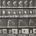 Woman throwing a bucket of water Poster by Eadweard Muybridge