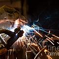 worker welding steel with white sparks Print by Oliver Sved