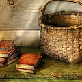 Writer - A Basket and some Books Poster by Mike Savad