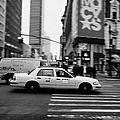 yellow cab taxi blurs past pedestrian waiting at crosswalk on Broadway outside macys new york usa Poster by Joe Fox