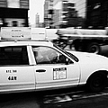 yellow cab with advertising hoarding blurring past crosswalk and pedestrians new york city usa Print by Joe Fox
