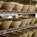 Baskets at a Bakery Print by Inti St. Clair