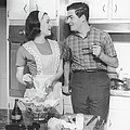 Couple Standing In Kitchen, Smiling, (b&w) Print by George Marks