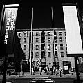 entrance to the albert dock and beatles museum liverpool merseyside england uk Print by Joe Fox