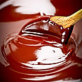 Melted chocolate and spoon Print by Elena Elisseeva