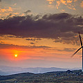 Wind Turbines at Sunset Poster by Andre Goncalves