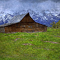 Grand Teton Iconic Mormon Barn Spring Storm Clouds Poster by John Stephens