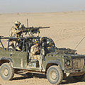 Gurkhas Patrol Afghanistan In A Land Print by Andrew Chittock