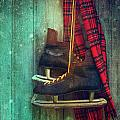 Old ice skates hanging on barn wall Poster by Sandra Cunningham