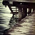 old wooden pier with stairs into the lake Poster by Joana Kruse