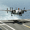 A C-2a Greyhound Prepares To Land Poster by Stocktrek Images