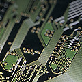 A Close View Of A Silicon Circuit Board Poster by Taylor S. Kennedy