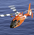 A Coast Guard Hh-65a Dolphin Rescue Poster by Stocktrek Images