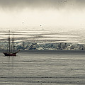 A Double-masted Sailboat Floats Near An Poster by Norbert Rosing