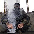 A Marine Fills The Gas Chamber Print by Stocktrek Images