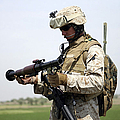 A Marine Looks At A Brand New Print by Stocktrek Images