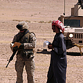 A Soldier Communicates With A Local Print by Stocktrek Images
