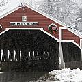 A Traditional Covered Bridge On A Snowy Print by Tim Laman