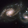 A Triplet Of Galaxies Known As Arp 274 Poster by Stocktrek Images