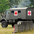 A Unimog In An Ambulance Version In Use Print by Luc De Jaeger