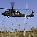A U.s. Army Uh-60 Black Hawk Helicopter Print by Stocktrek Images