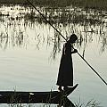 A Woman Stands At The End Of A Rowboat Poster by Lynn Abercrombie