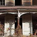 Abandoned House Facade Rusty Porch Roof Print by John Stephens