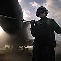 Airman Holds Up The Safety Shot Line Poster by Stocktrek Images