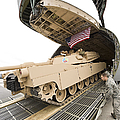 Airmen Load A Tank Into A C-5m Super Poster by Stocktrek Images