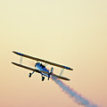 Airshow Smoke Trail At Sunset Poster by Jim McKinley
