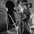 Amelia Earhart 1897-1937 Standing Poster by Everett