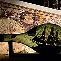 An Antique Map Provides The Backdrop Poster by Todd Gipstein