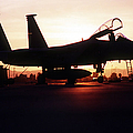 An F-15c Eagle Aircraft Silhouetted Print by Stocktrek Images