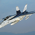 An Fa-18f Super Hornet Conducts Poster by Stocktrek Images