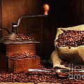 Antique coffee grinder with beans Print by Sandra Cunningham