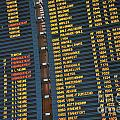 Arrival board at Paris Charles de Gaulle International Airport Print by Sami Sarkis