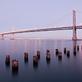 Bay Bridge And Pilings Print by Photograph by Daniel Pivnick