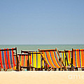 Beach chairs colorful  Print by Panupong Roopyai