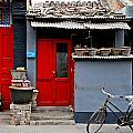 Bicycle and Red Door Print by Dean Harte